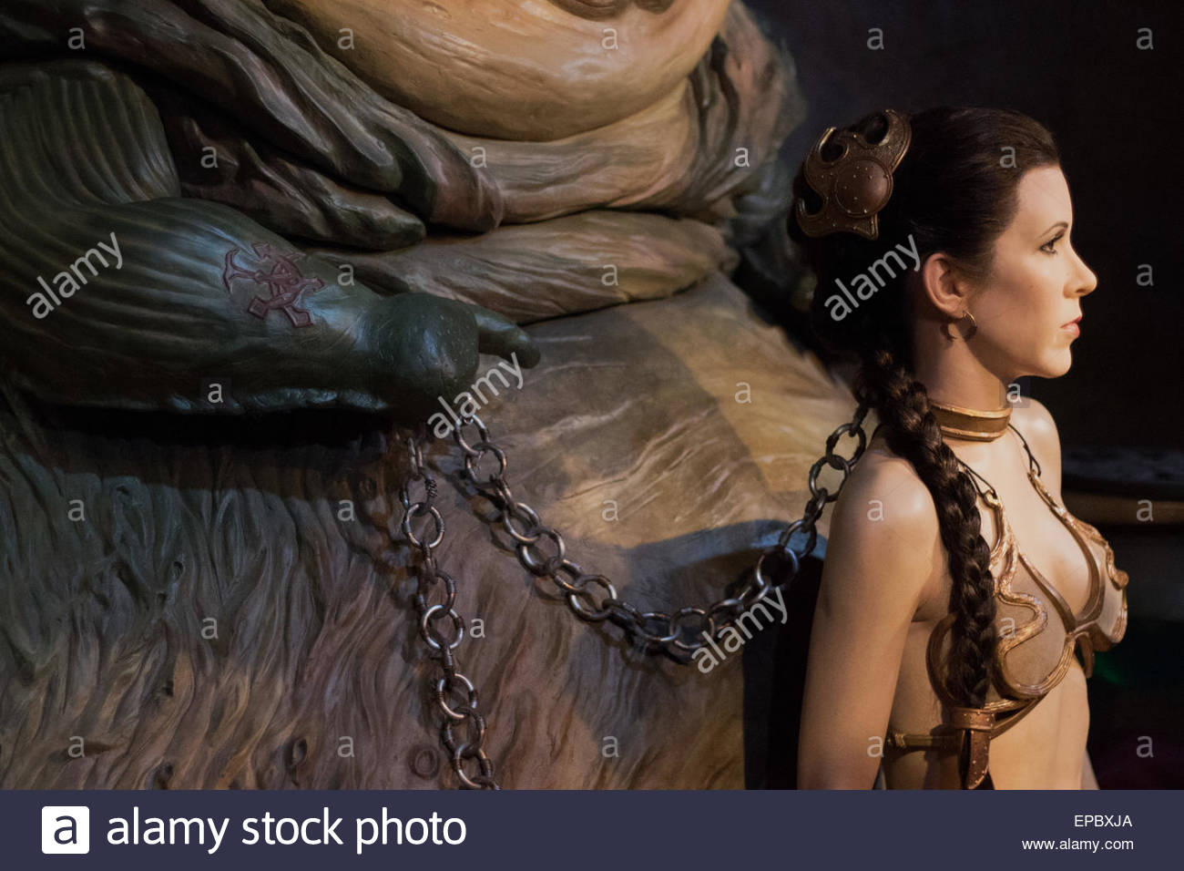 Princess leia chained up in her Golden bikini by Jabba the Hutt - Stock Image