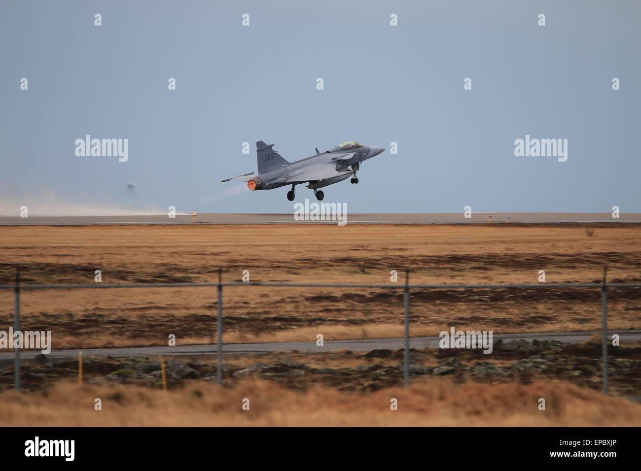 Swedish JAS-39 Gripen departing Keflavik Air base during Iceland Air Meet 2014. Stock Photo