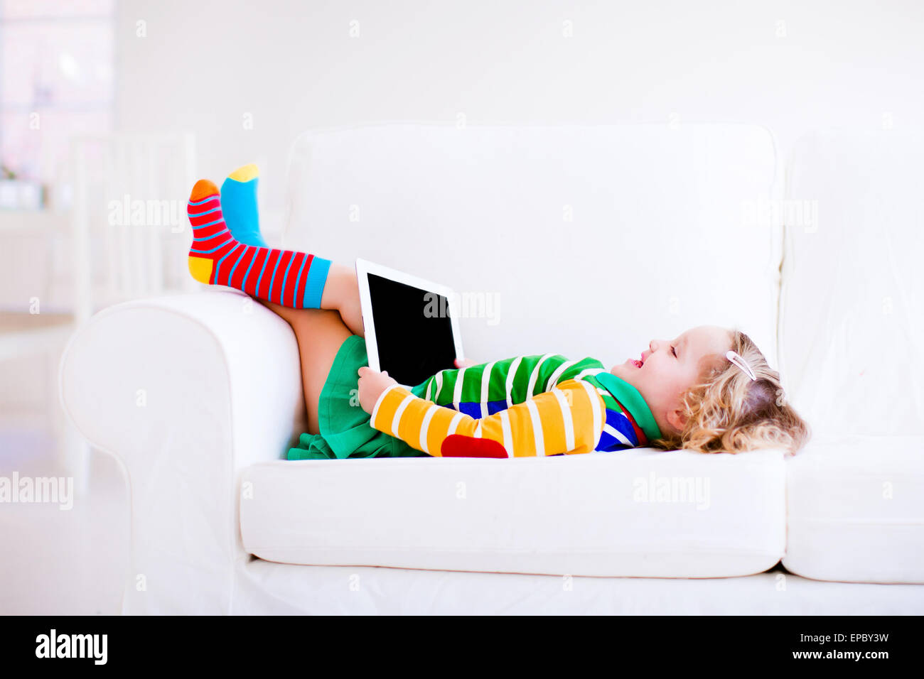 Awesome Funny Little Toddler Girl With Tablet Pc Relaxing On A White Dailytribune Chair Design For Home Dailytribuneorg