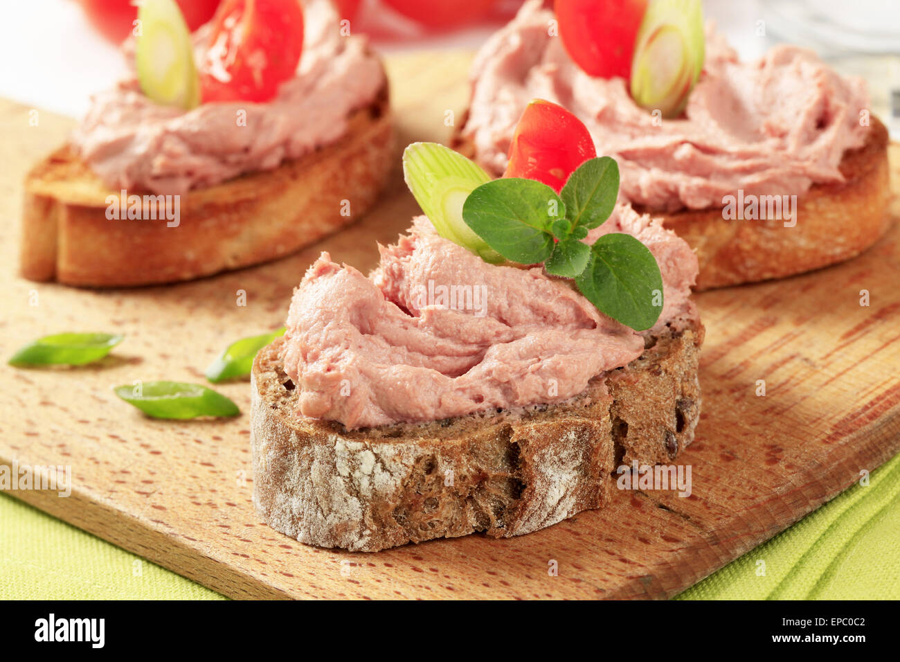 Slices of bread with smooth meat spread - Stock Image