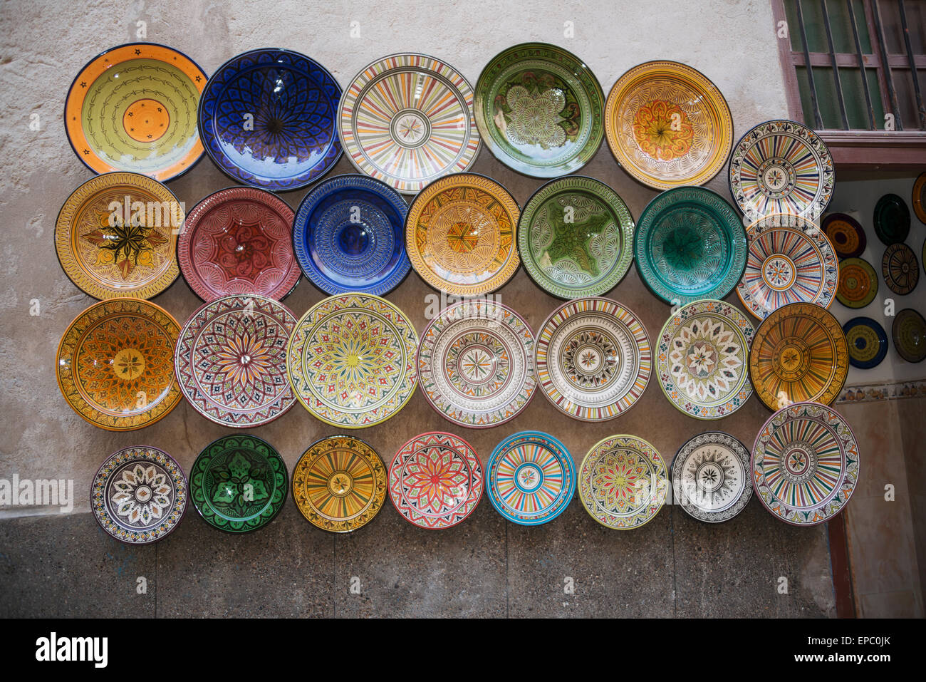 Array of beautifully designed plates for sale on wall display Stock ...