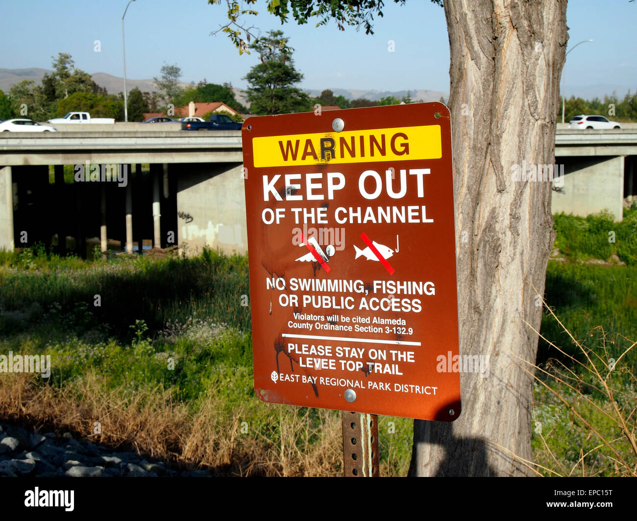 Warning sign, Alameda Creek Regional Trail, Union City, CA USA - Stock Image