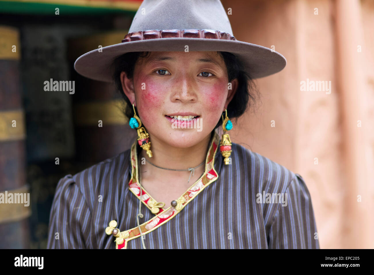 Portrait of a young Tibetan woman; Dege, Sichuan, China - Stock Image