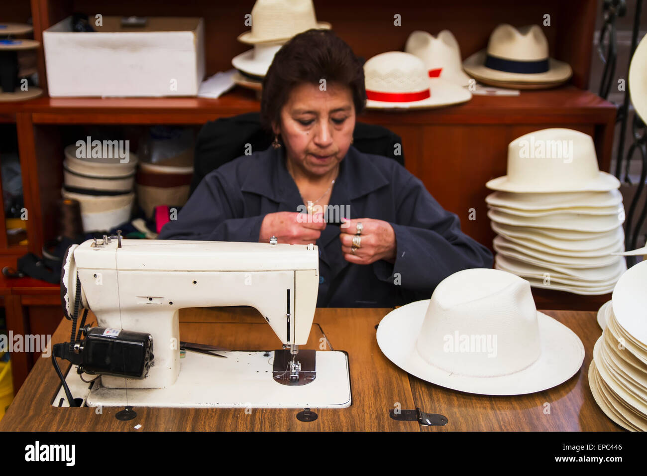 Woman sewing the black brim on to a panama hat at the Barranco Panama Hat  Factory eb028243c21