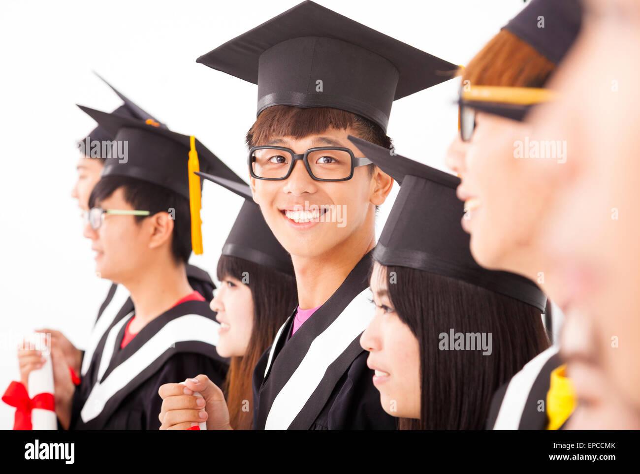 85e6941a06d asian male college graduate at graduation with classmates - Stock Image