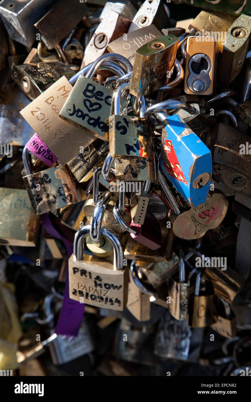 Thousands of locks attache to the bridge Pont des Arts over the Seine River for good luck.  Paris, France. - Stock Image