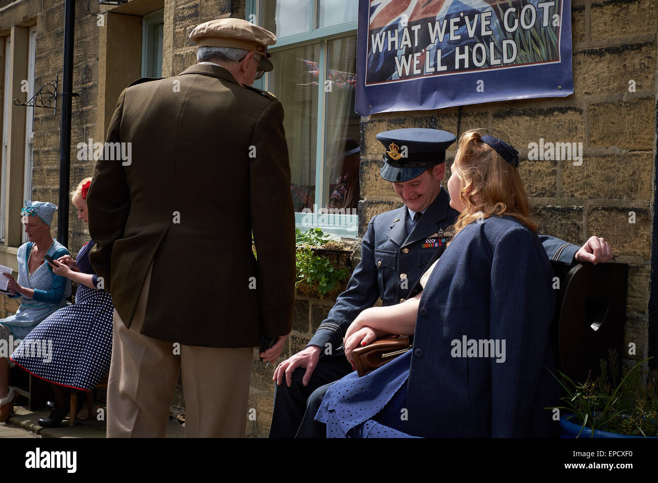 Coy looking man in British RAF uniform with girl Stock Photo