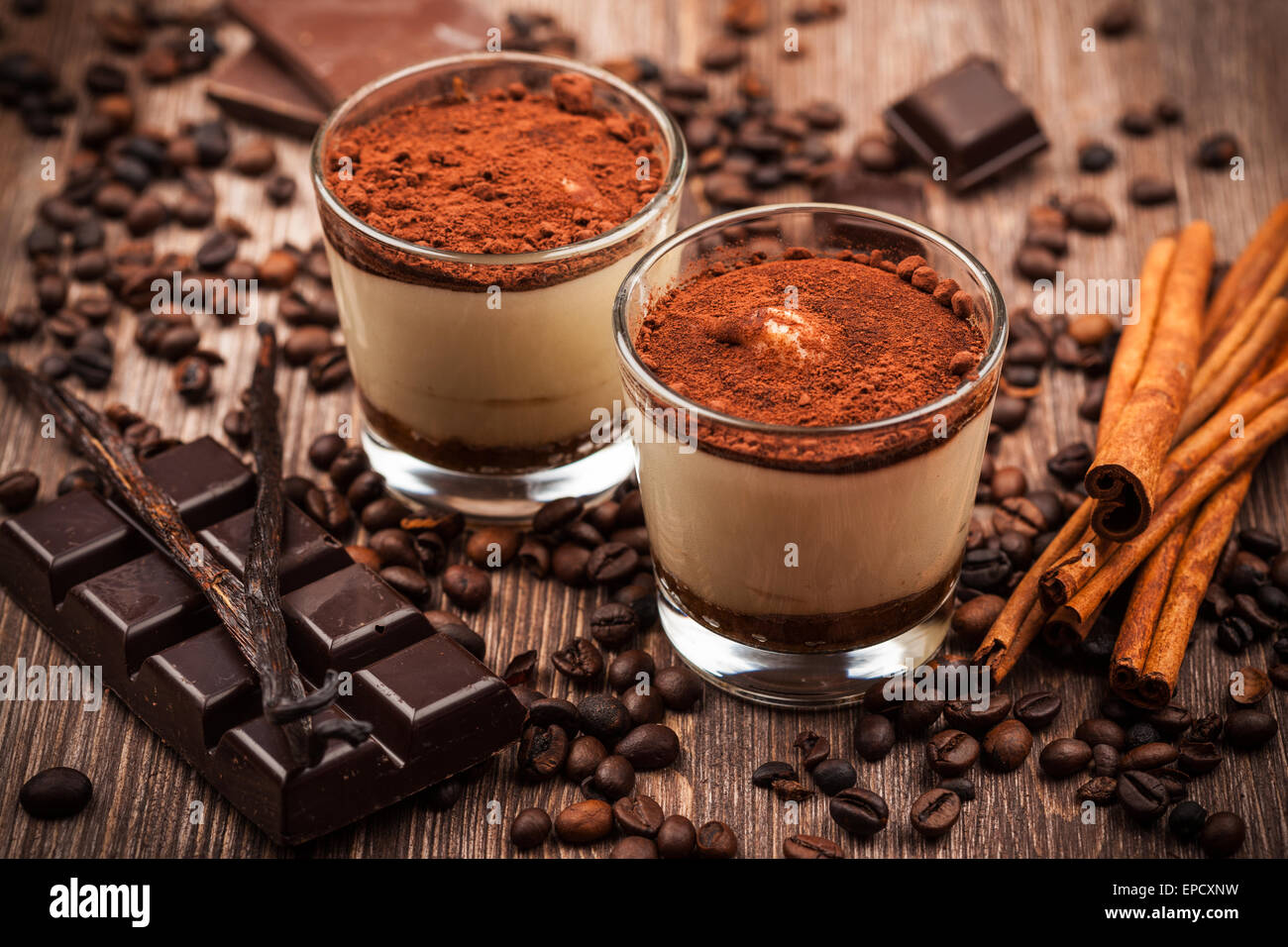 Delicious tiramisu dessert with ingredients - Stock Image