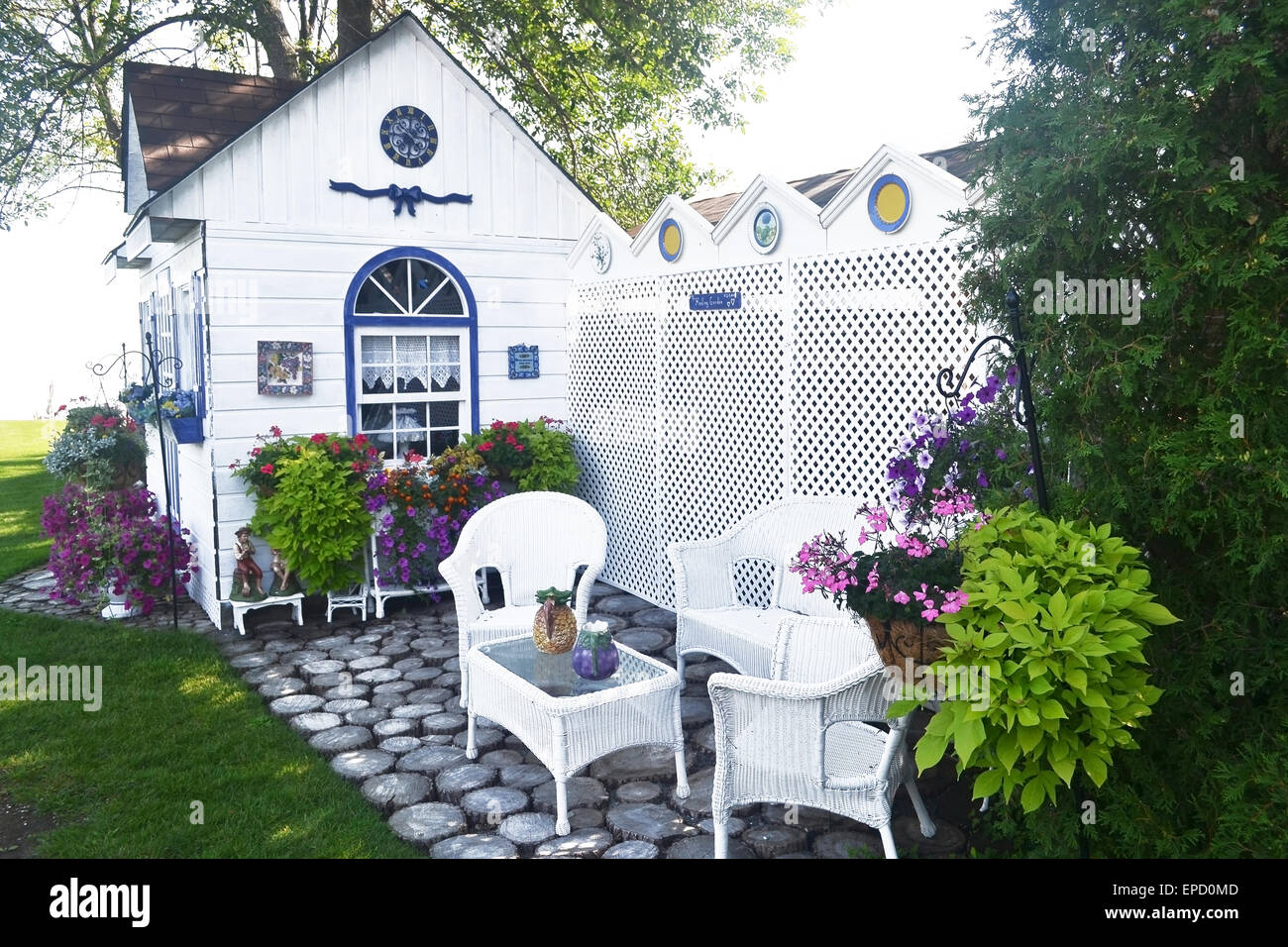 A Beautiful Small Garden Shed With Nice Chairs And A Lot Of Flowers Stock Photo Alamy