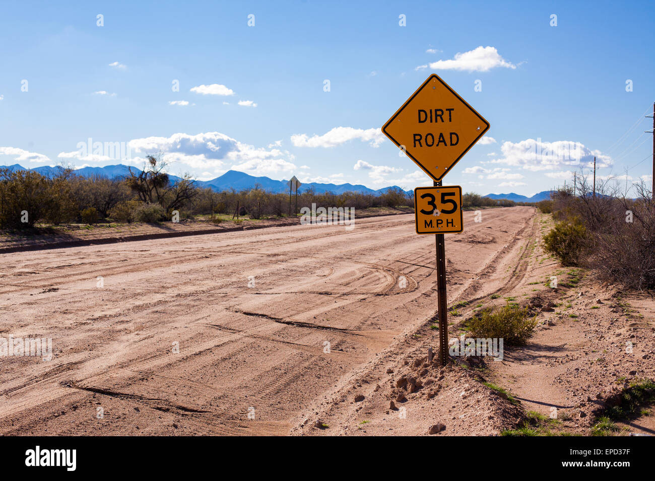 Dirt Road with sign - Stock Image