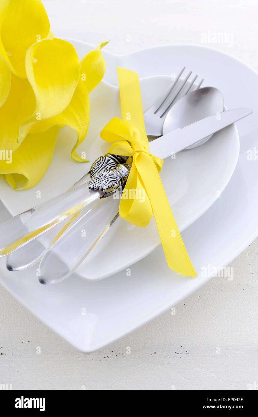 Yellow and white theme wedding table place setting with heart shape ...