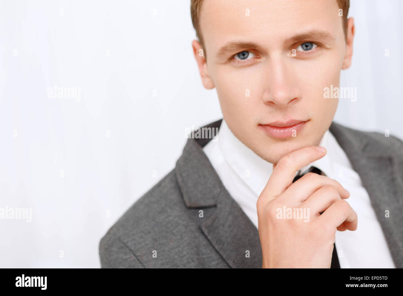 Close up of man touching his chin. - Stock Image