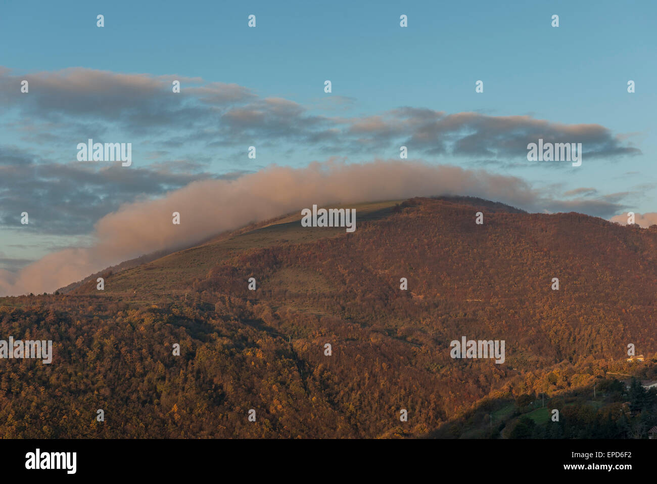 Sunrise on mount Strega in Autumn, blue sky with clouds, Apennines, Marche, Italy - Stock Image