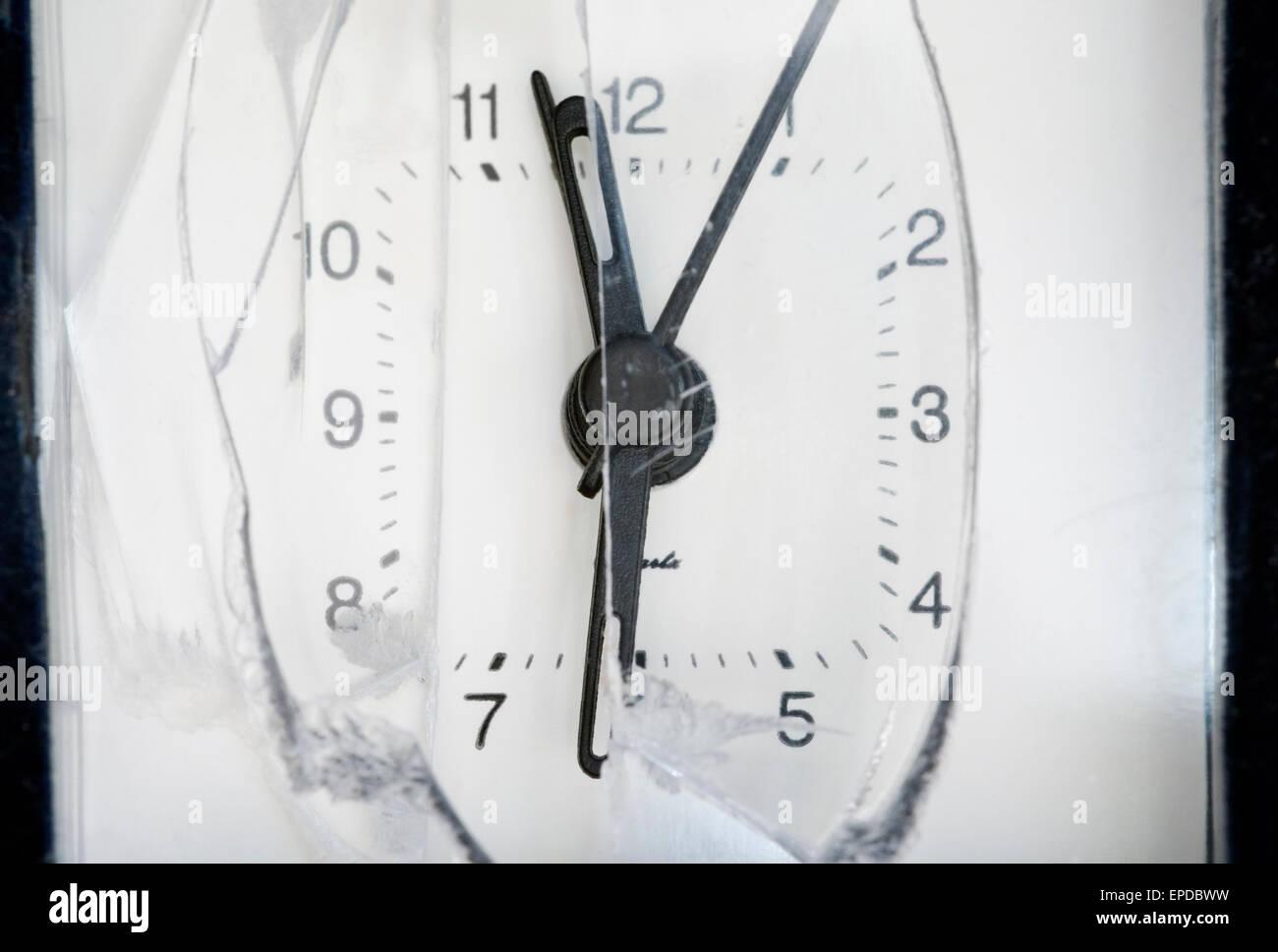 Smashed alarm clock - Stock Image
