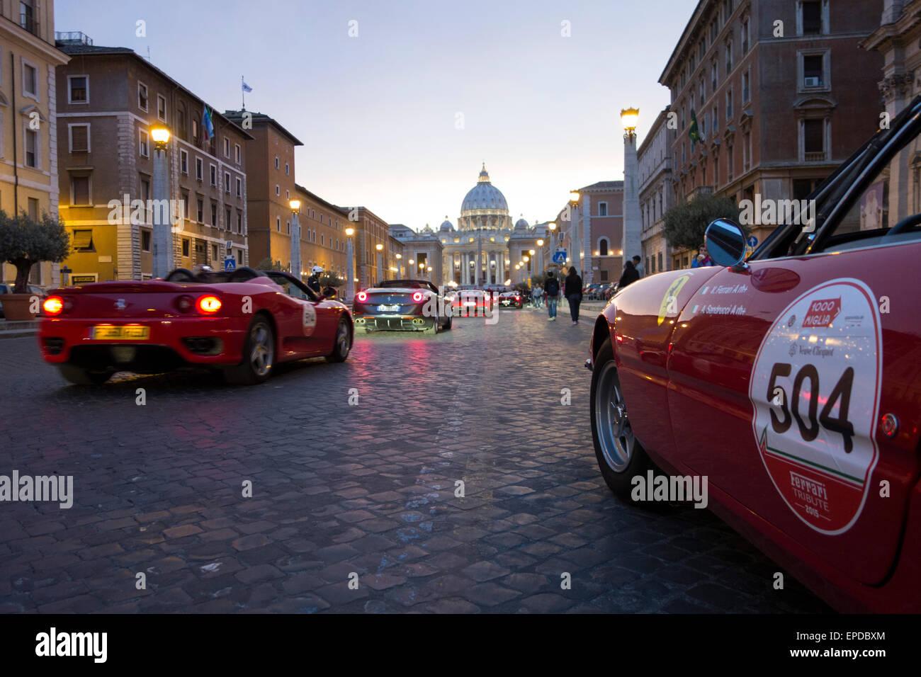 Rome. Italy. Cars taking part in the Mille Miglia classic car rally gather on Via della Conciliazione. - Stock Image