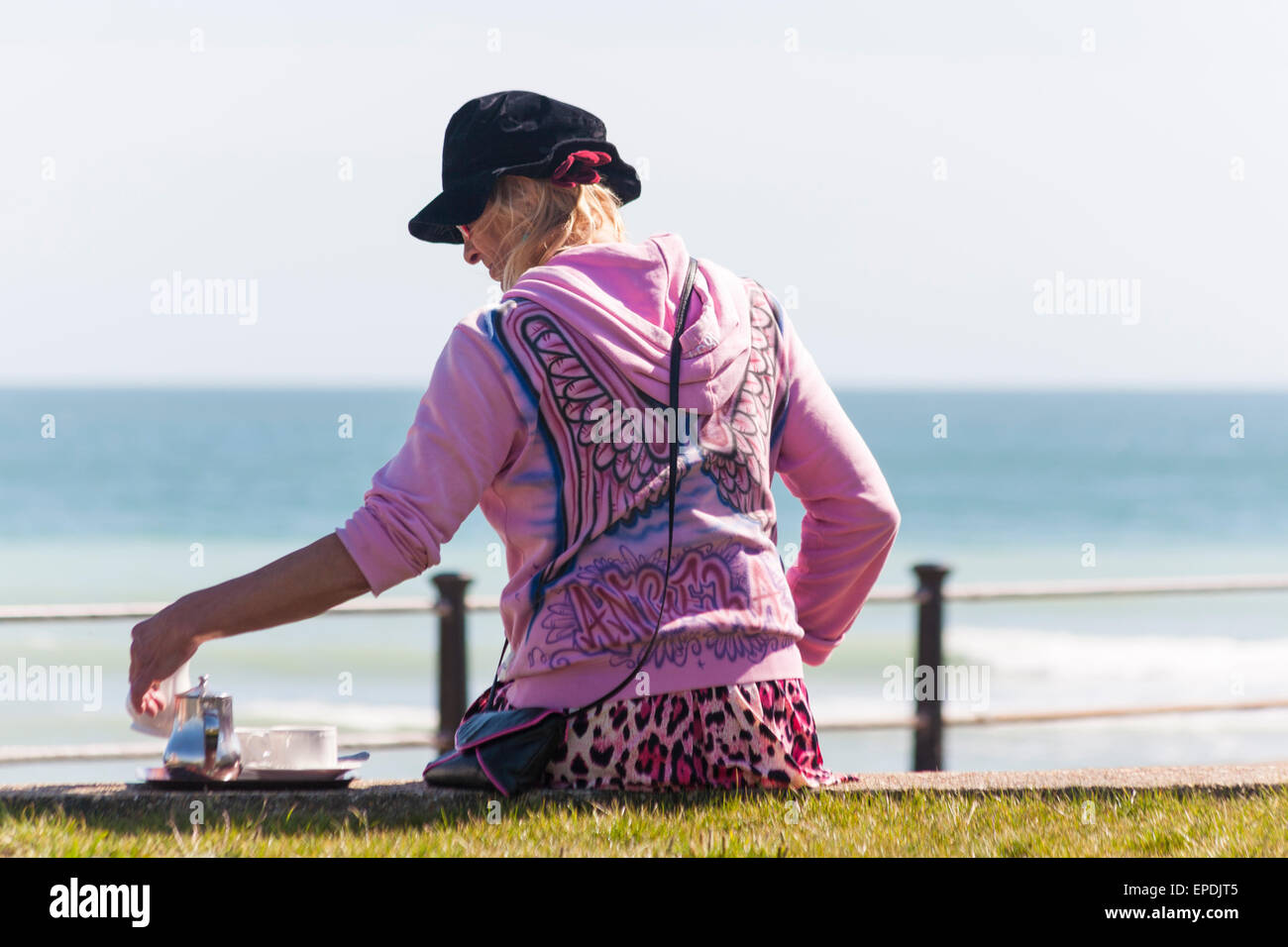 Enjoying a pot of tea and sunshine at Freshwater Bay at Isle of Wight, Hampshire UK in May - relaxing and enjoying Stock Photo