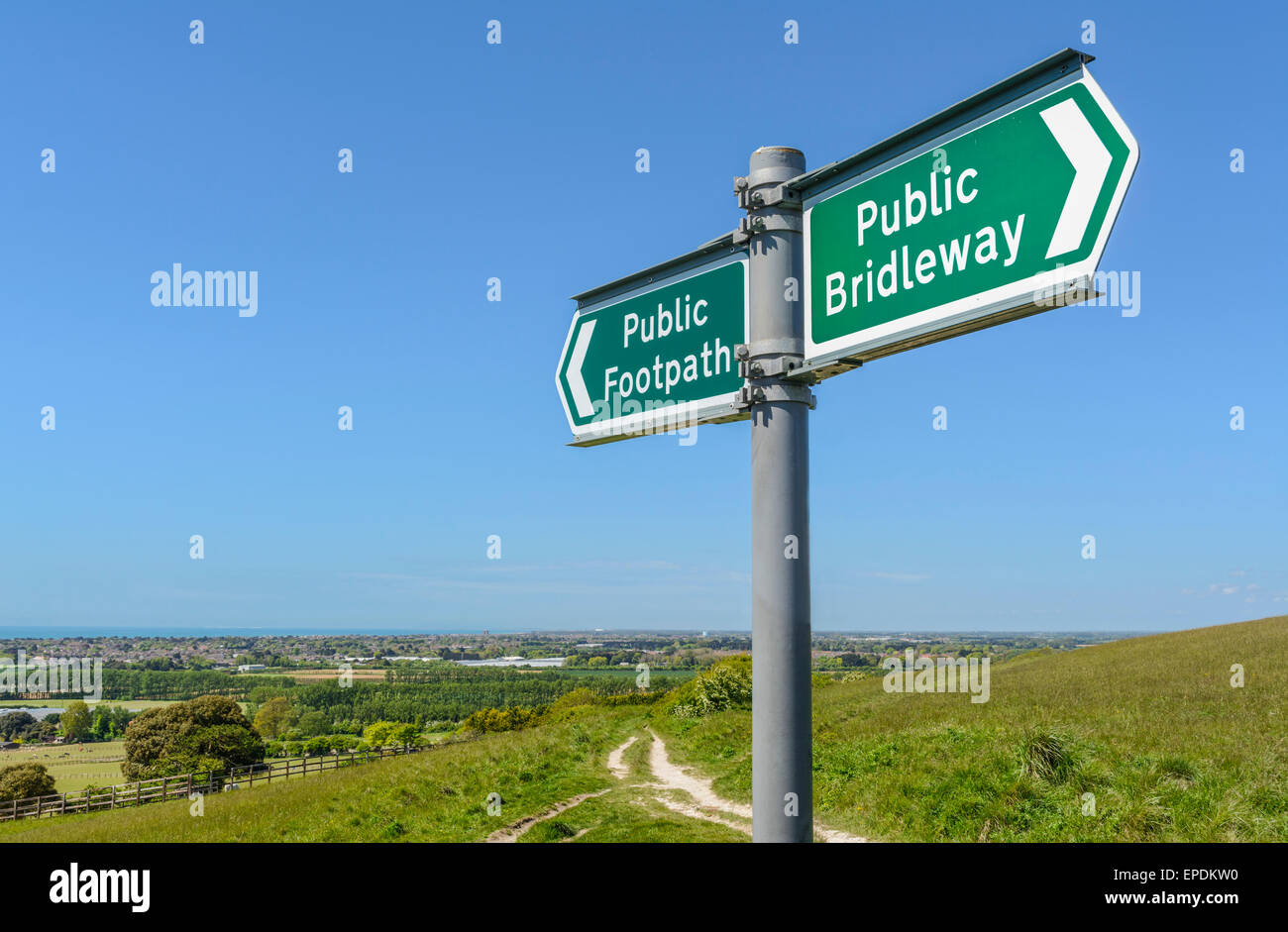 Public Footpath and Public Bridleway sign on a hill at Highdown in West Sussex, England, UK. - Stock Image