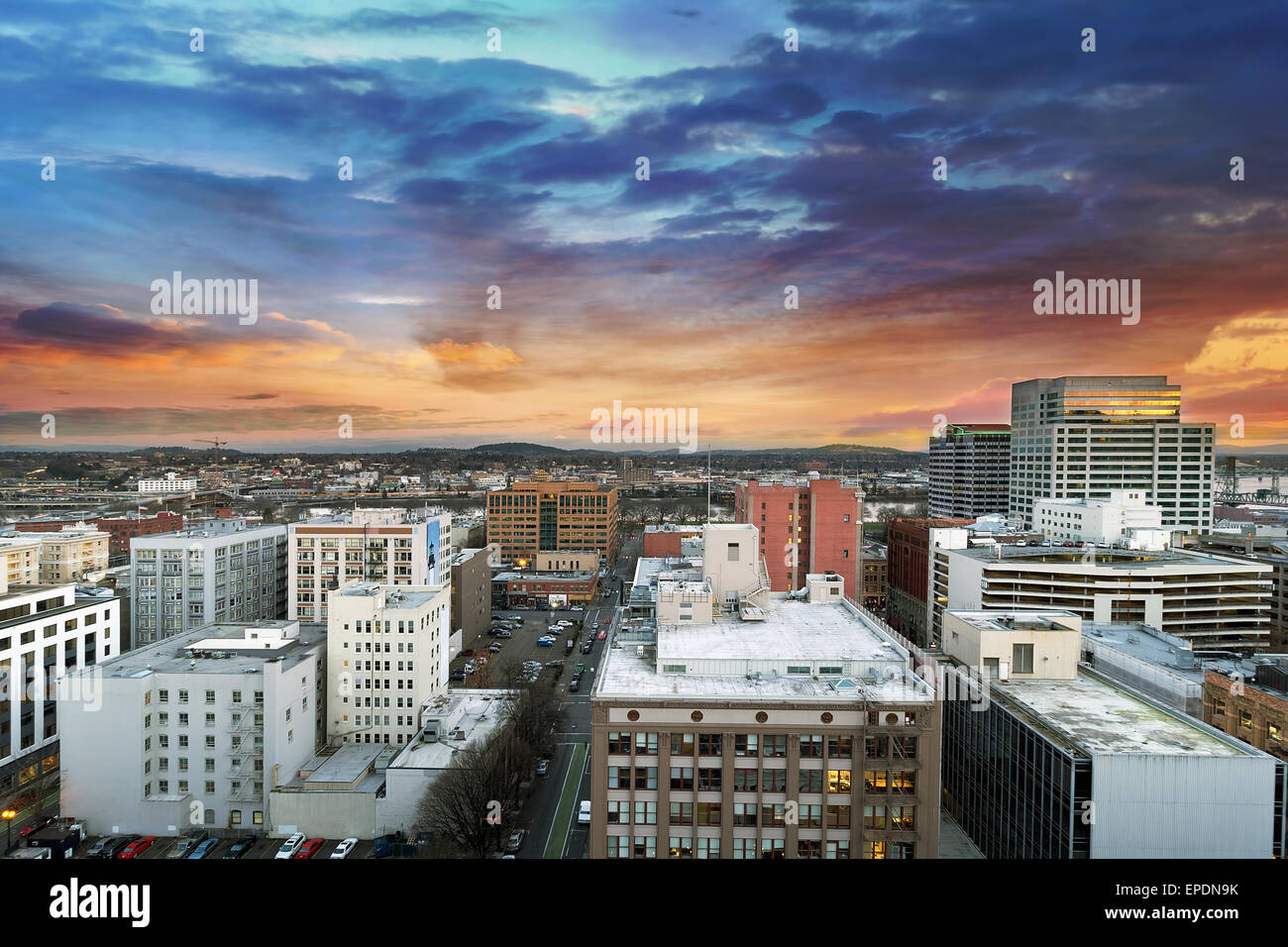 Sunset Over Portland Oregon Downtown Cityscape with Mt Hood in the Distant - Stock Image