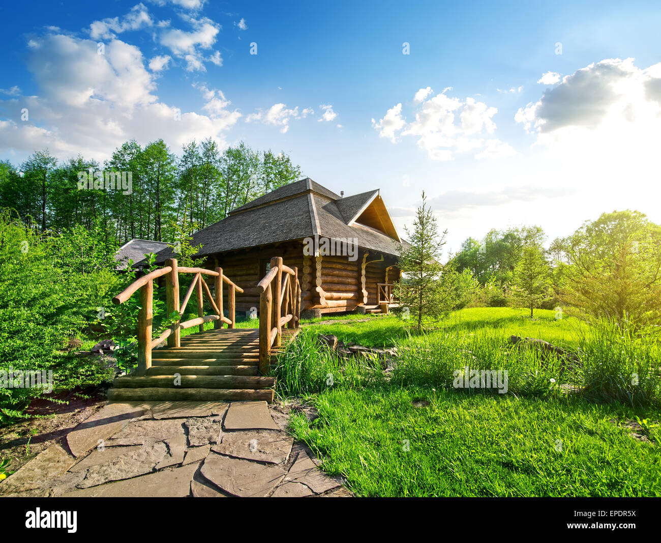 Wooden bridge and house of log in the forest Stock Photo