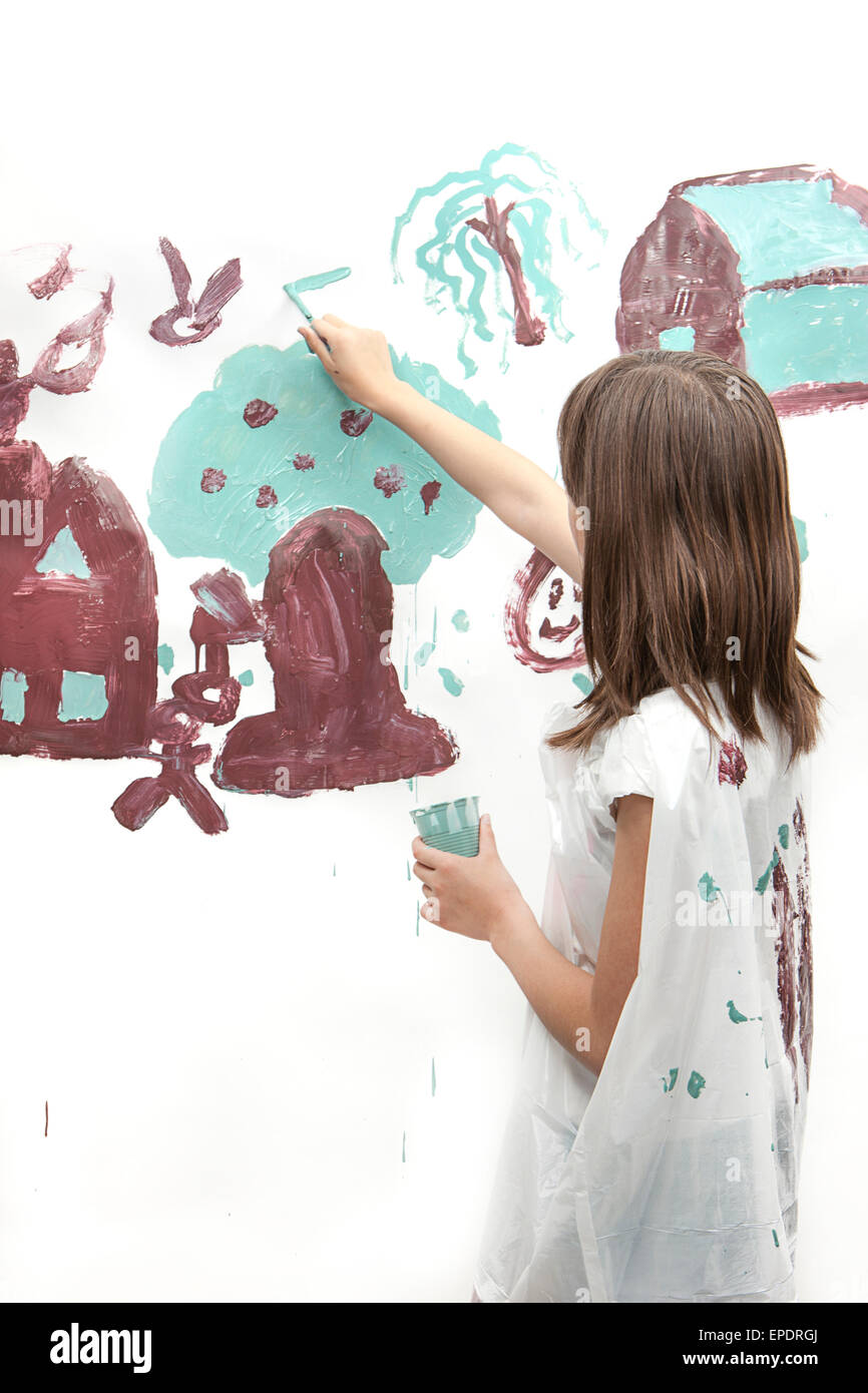 Girl works on simple painting. - Stock Image