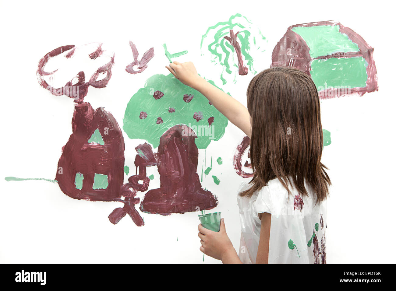 Girl paints a picture. - Stock Image