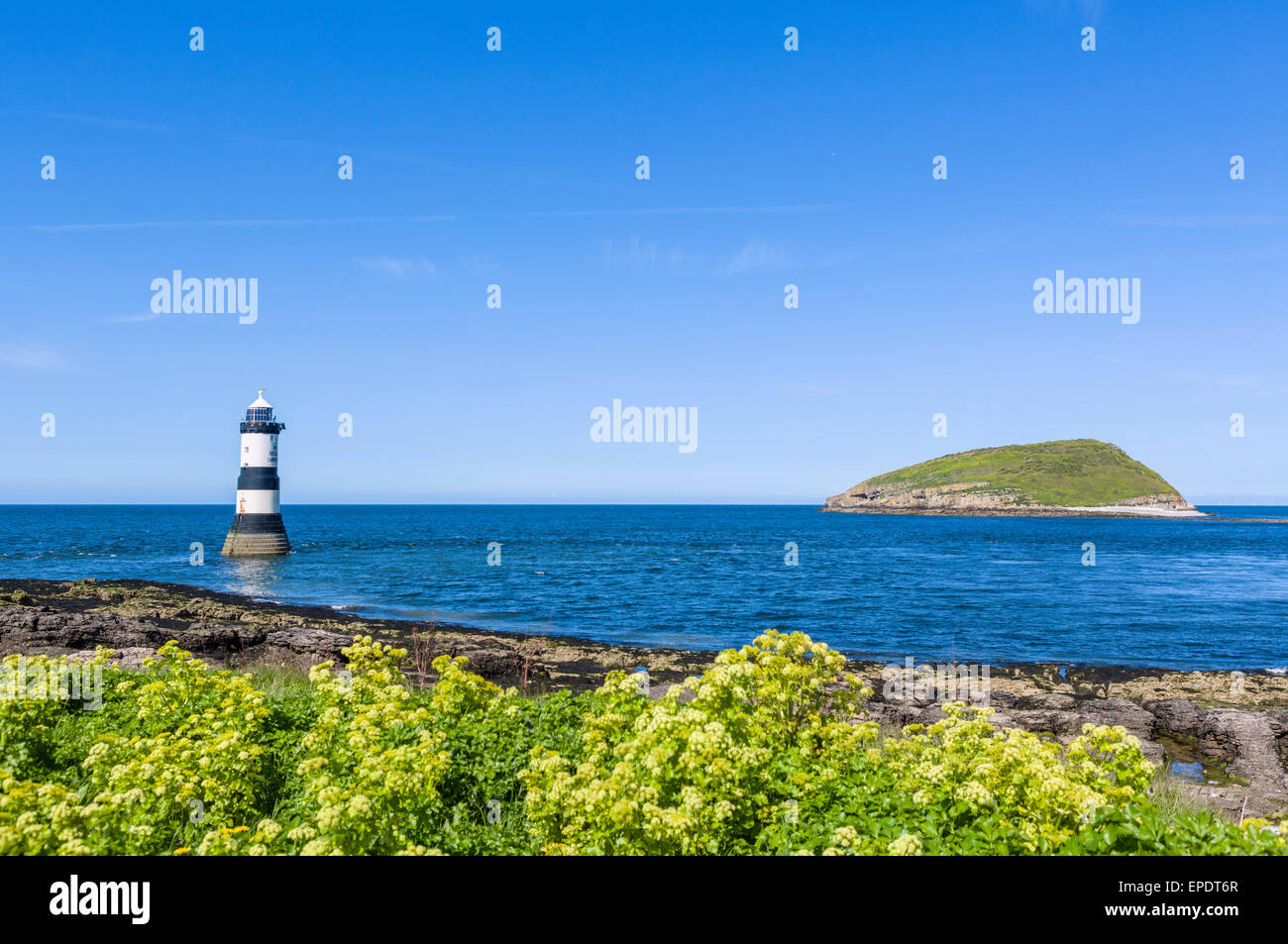 Lighthouse and Puffin Island from Penmon Point,  Anglesey, Wales, UK - Stock Image