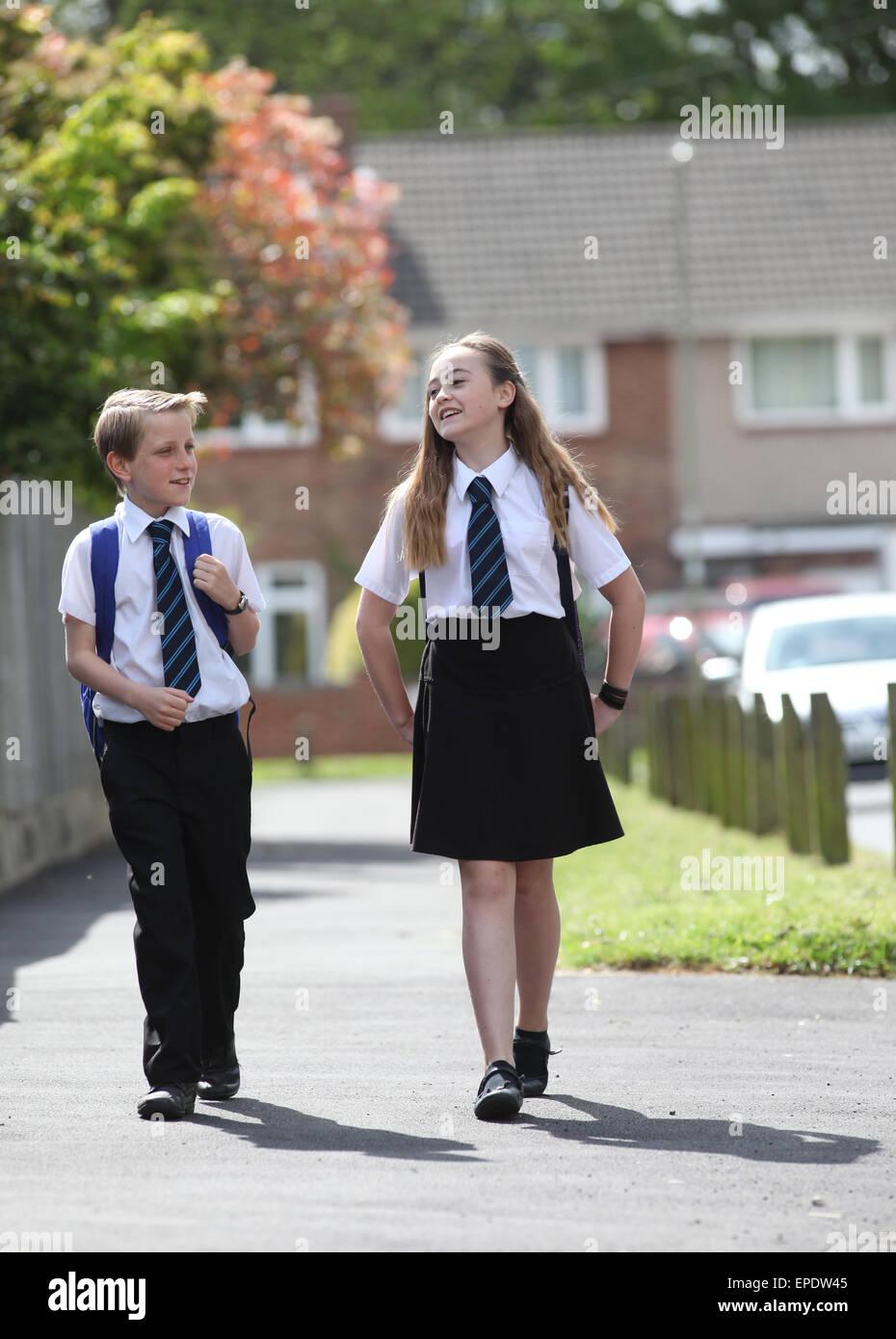 School pupils in uniform walking to school UK - Stock Image