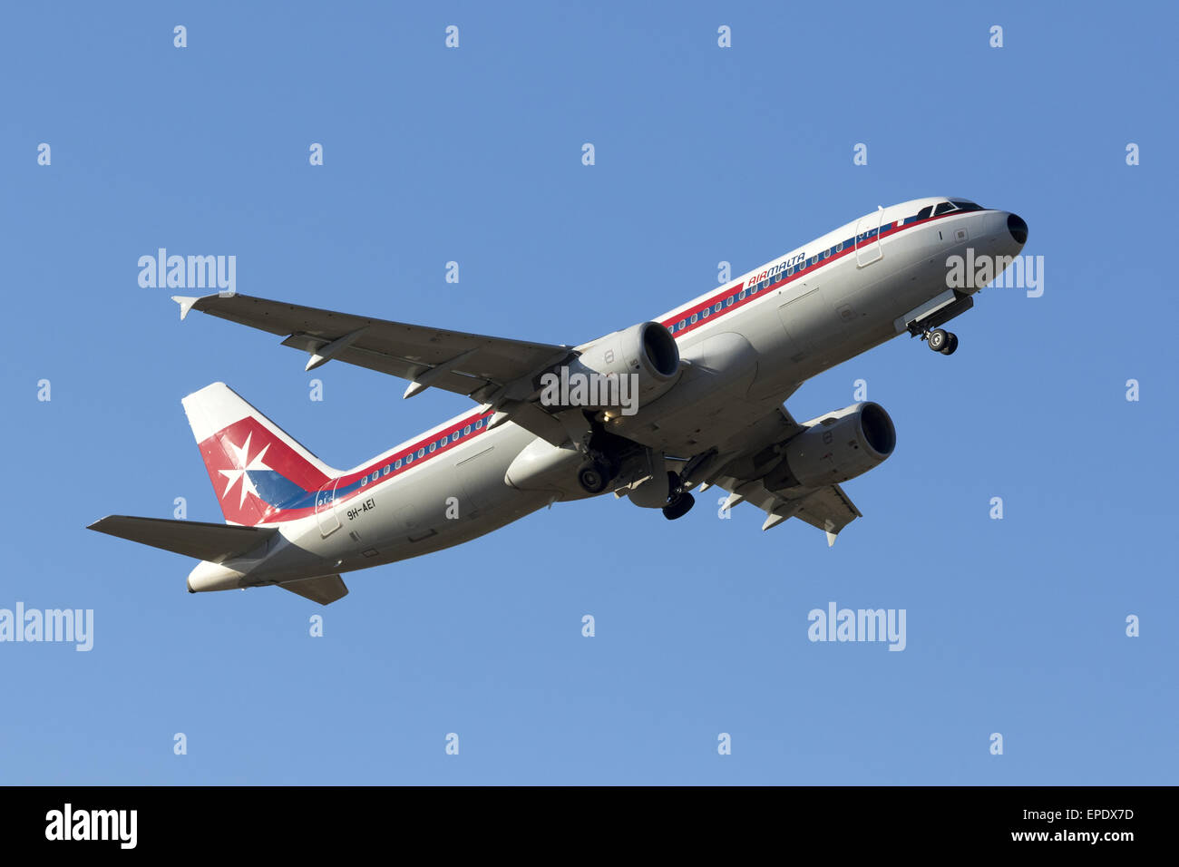 Air Malta Airbus A320-214 (9H-AEI) in retro livery takes off from runway 13. - Stock Image