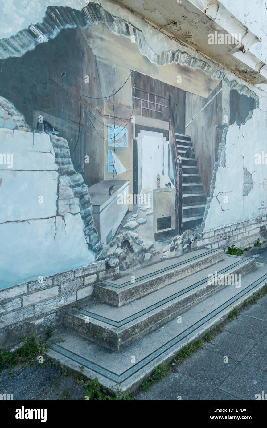 Murals painted on the side of the dilapidated Pier Head building. The seafront, Swanage. Dorset. UK - Stock Image