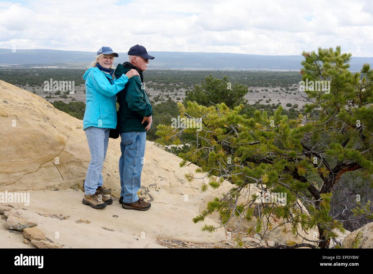 Senior Citizen siblings on sandstone bluff at El Morro National Monument New Mexico - USA - Stock Image