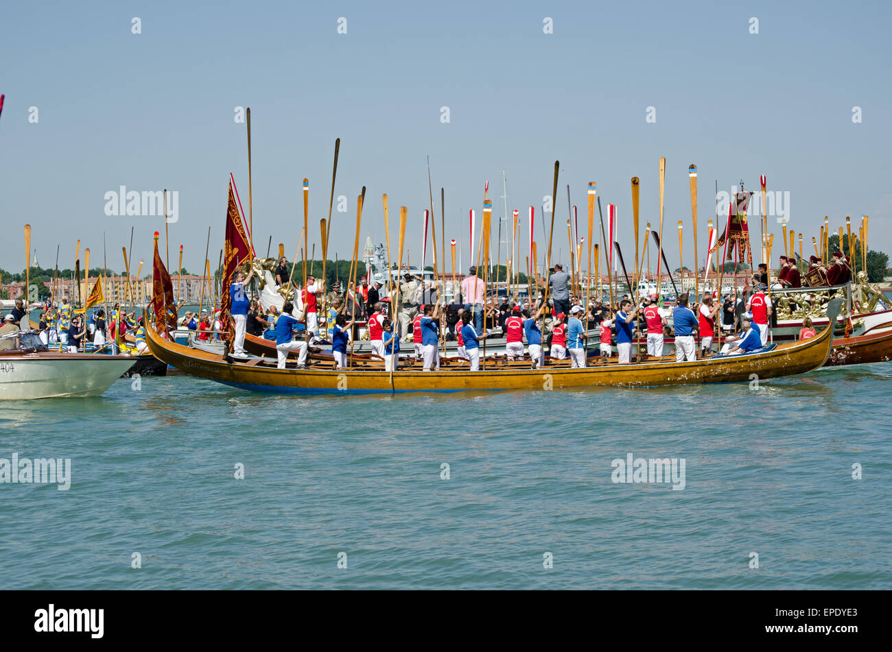 VENICE, ITALY - MAY 17, 2015:  Rowers standing with their oars to attention during the Marriage with the Sea ceremony, - Stock Image
