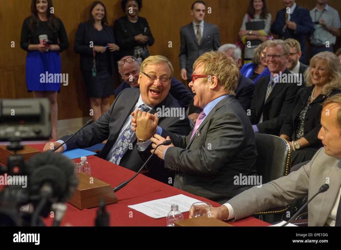 Singer Elton John and pastor of the Saddleback Church Rick Warren shake hands prior to testifying before the Senate - Stock Image