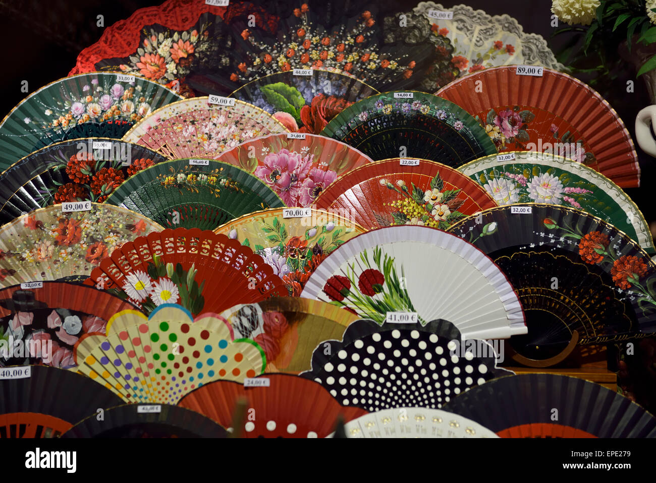 Flamenco hand fans in display window Andalusia Seville Spain - Stock Image