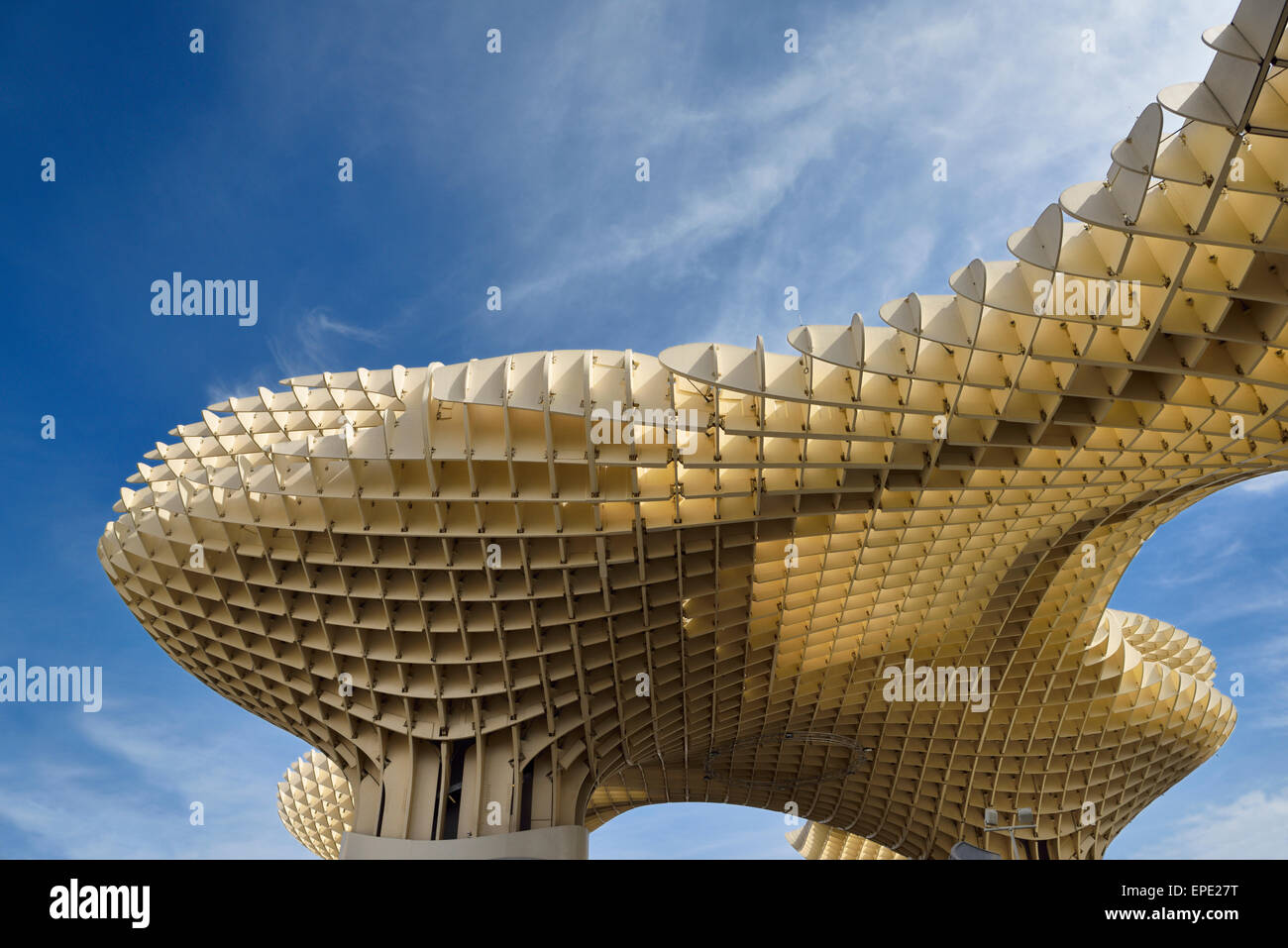 Modern abstract architecture shapes of Metropol Parasol at Plaza of the Incarnation Seville Spain against sky - Stock Image