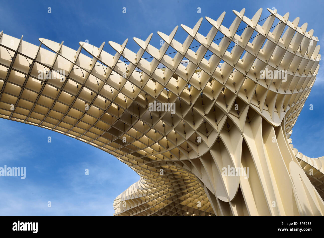 Modern abstract architecture of Metropol Parasol pod at Plaza of the Incarnation Seville Spain against sky - Stock Image