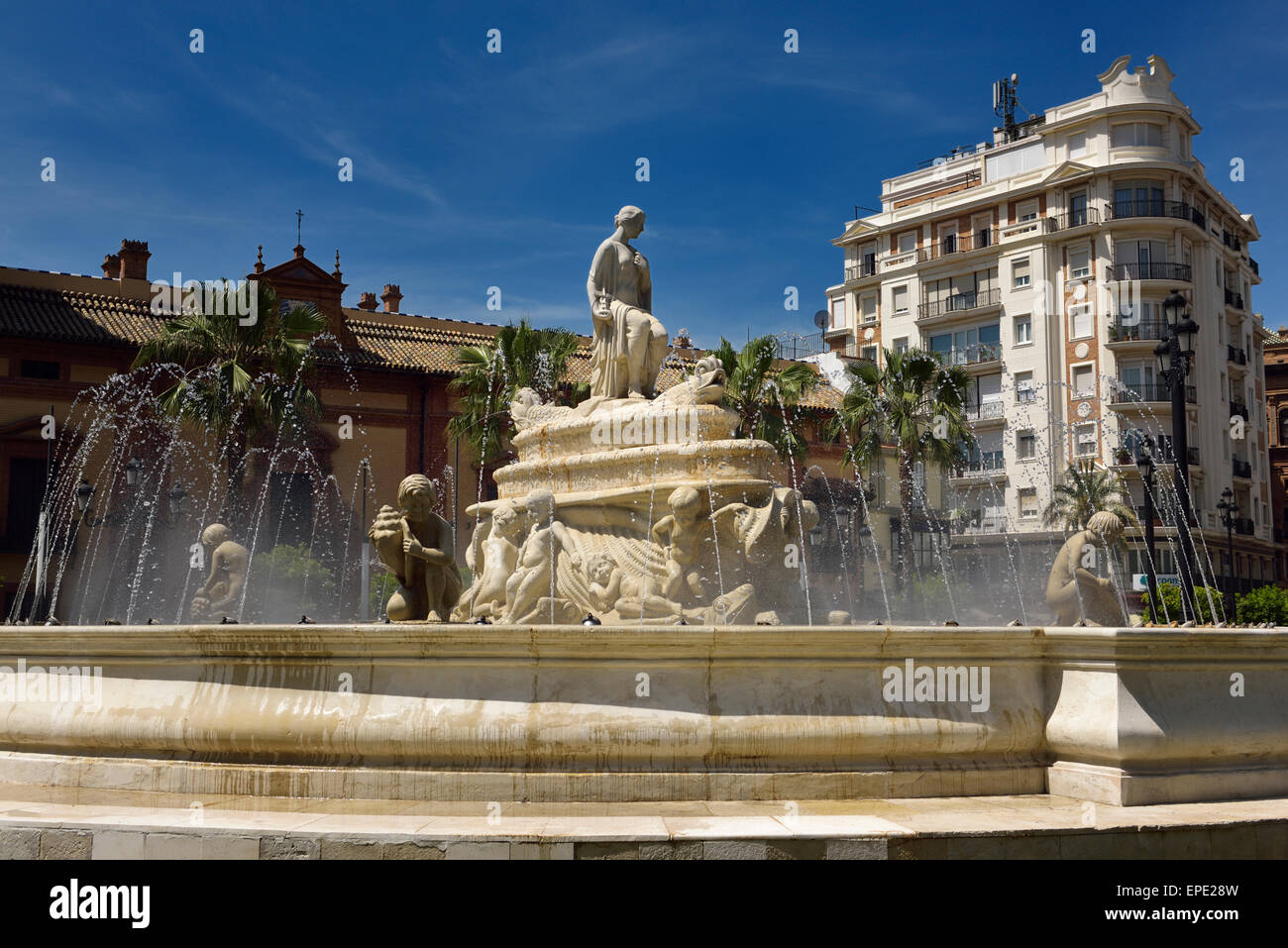 The water Fountain of Hispalis with nereid sea nymphs at Puerto de Jerez roundabout in Seville Spain - Stock Image