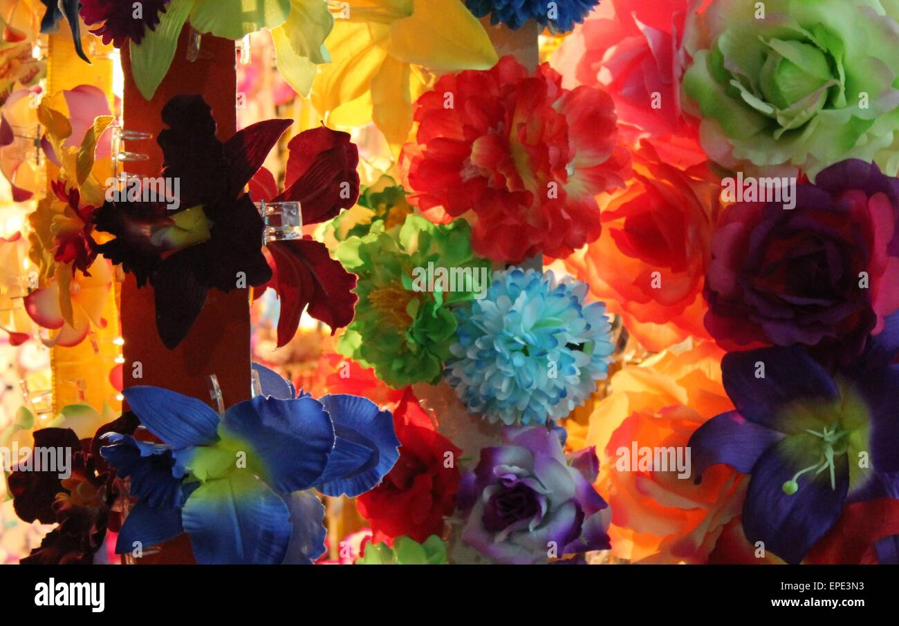 Silk Flower Hair Clips On Market Stall At Night Stock Photo