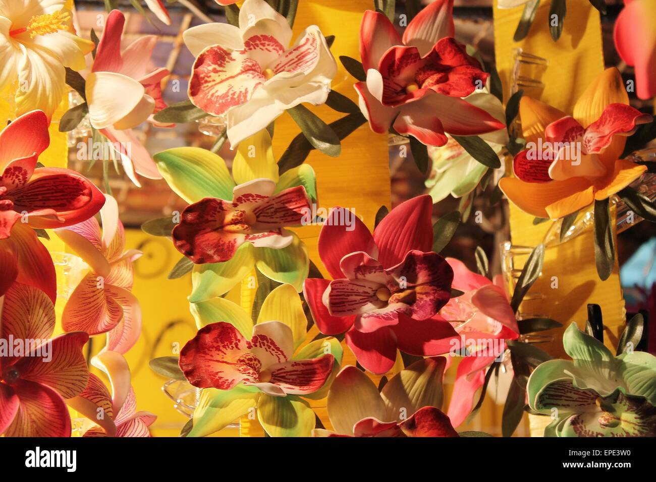 Various Silk Flower Orchid Hair Clips On Market Stall In Thailand