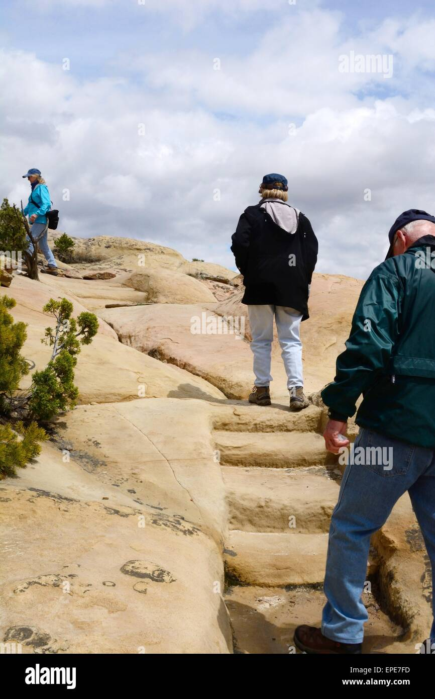 Senior Citizens climbing to the top at El Morro National Monument New Mexico - USA - Stock Image