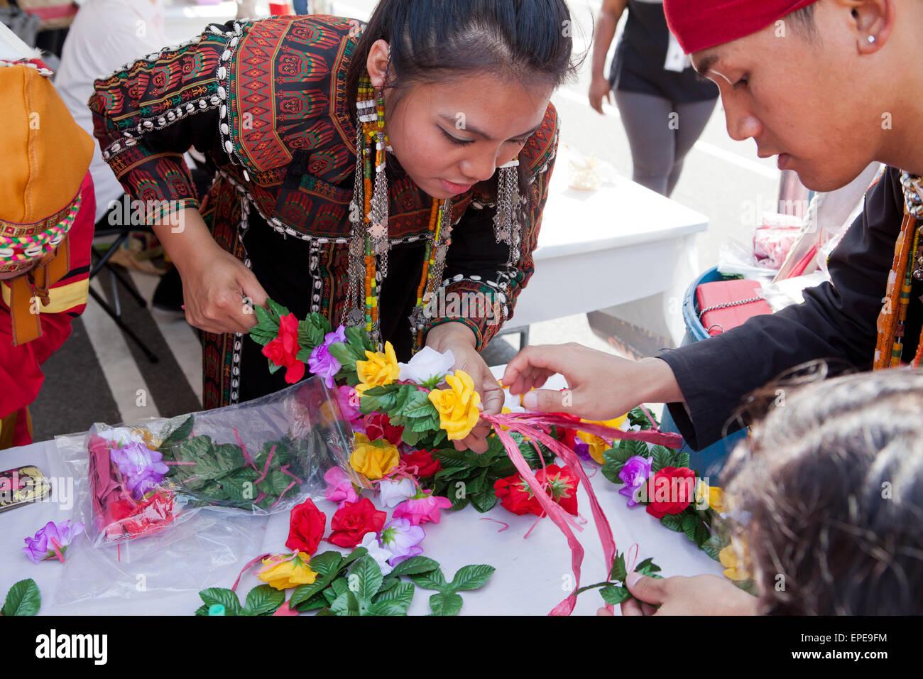 Taiwanese indigenous youth crafting decorations at National Asian Heritage Festival - Washington, DC USA - Stock Image