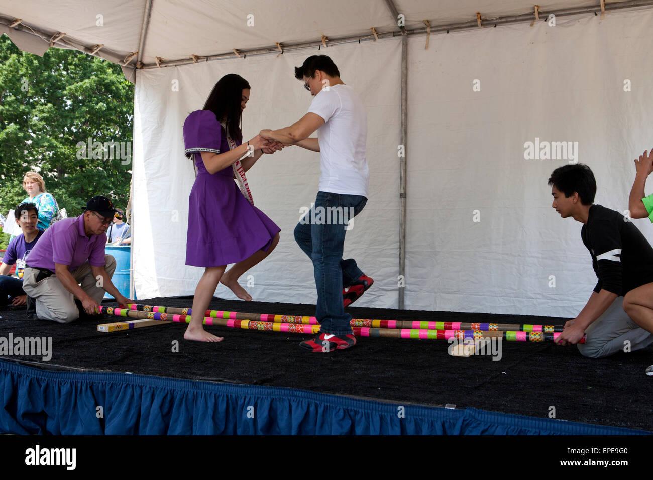 Tinikling (Philippine folk dance) performers on stage - National Asian Heritage Festival, Washington, DC USA - Stock Image
