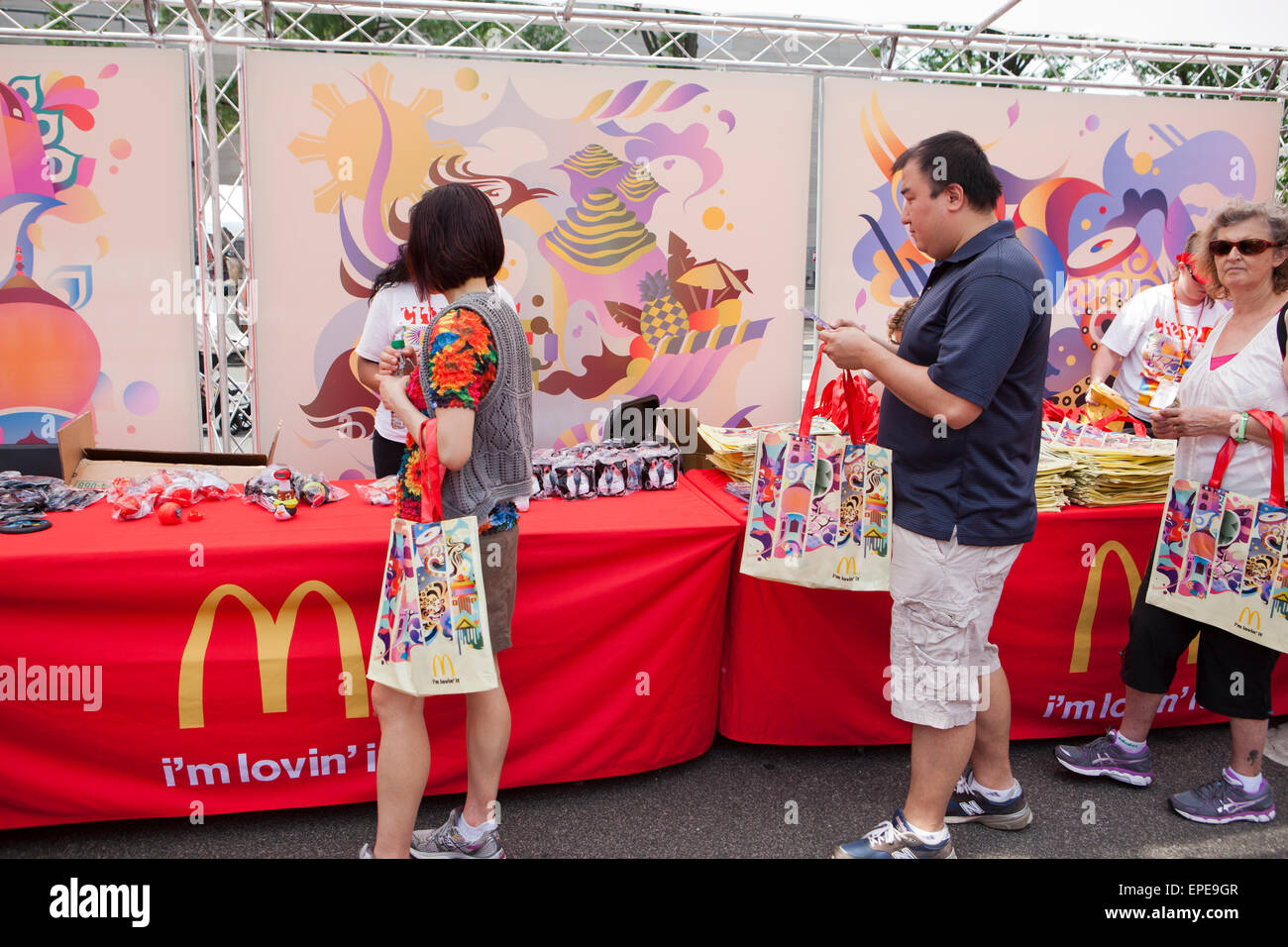 People at a McDonalds promotional booth at an outdoor festival - USA - Stock Image