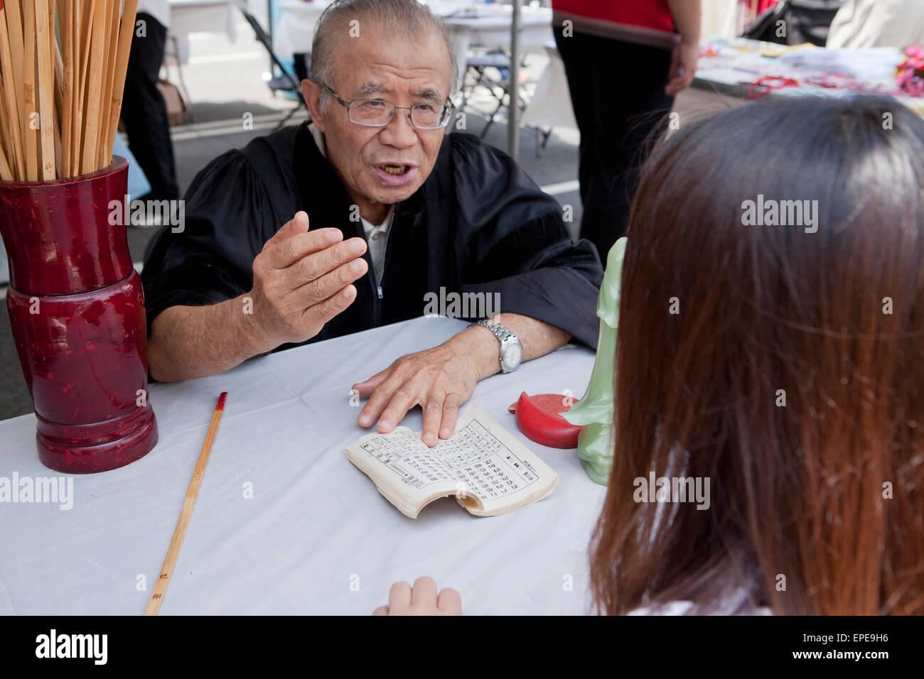 Chinese fortune teller, National Asian Heritage Festival - Washington, DC USA - Stock Image