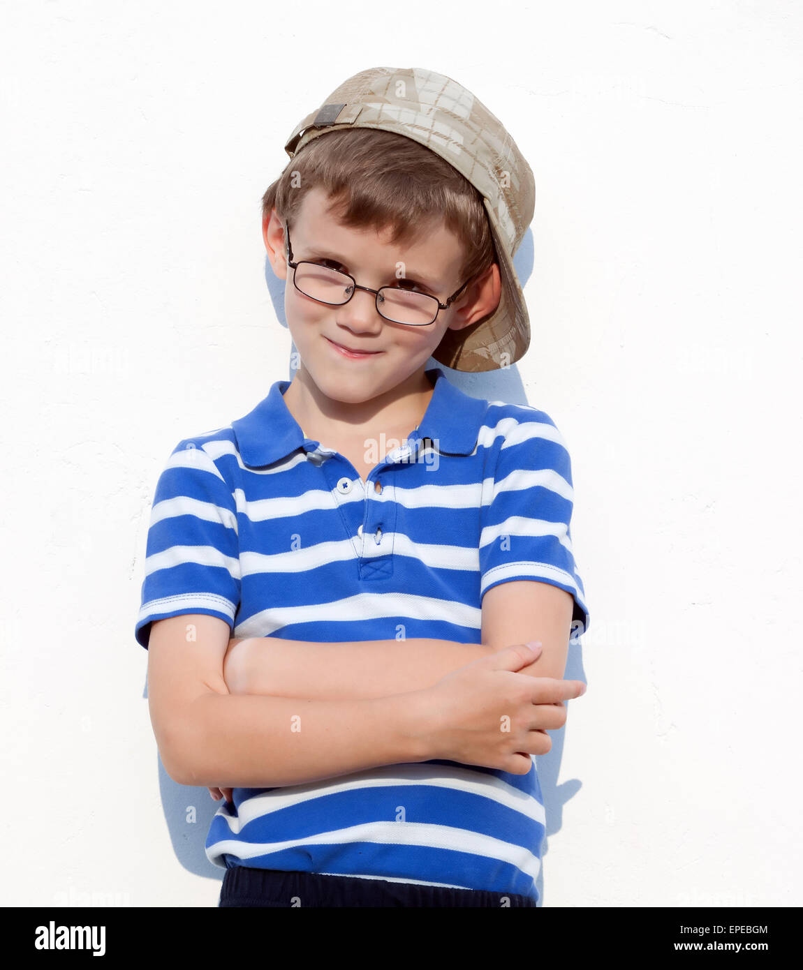 funny little bully boy in a cap and glasses.portrait - Stock Image