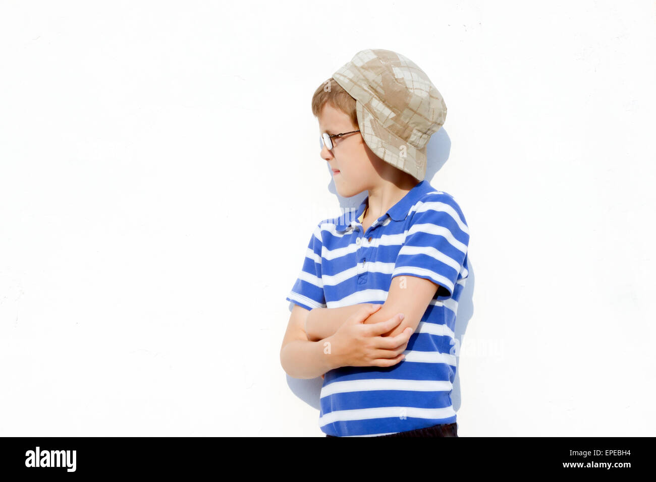 a161975009f2 the little boy a bully in glasses and a cap posing outdoors Stock ...