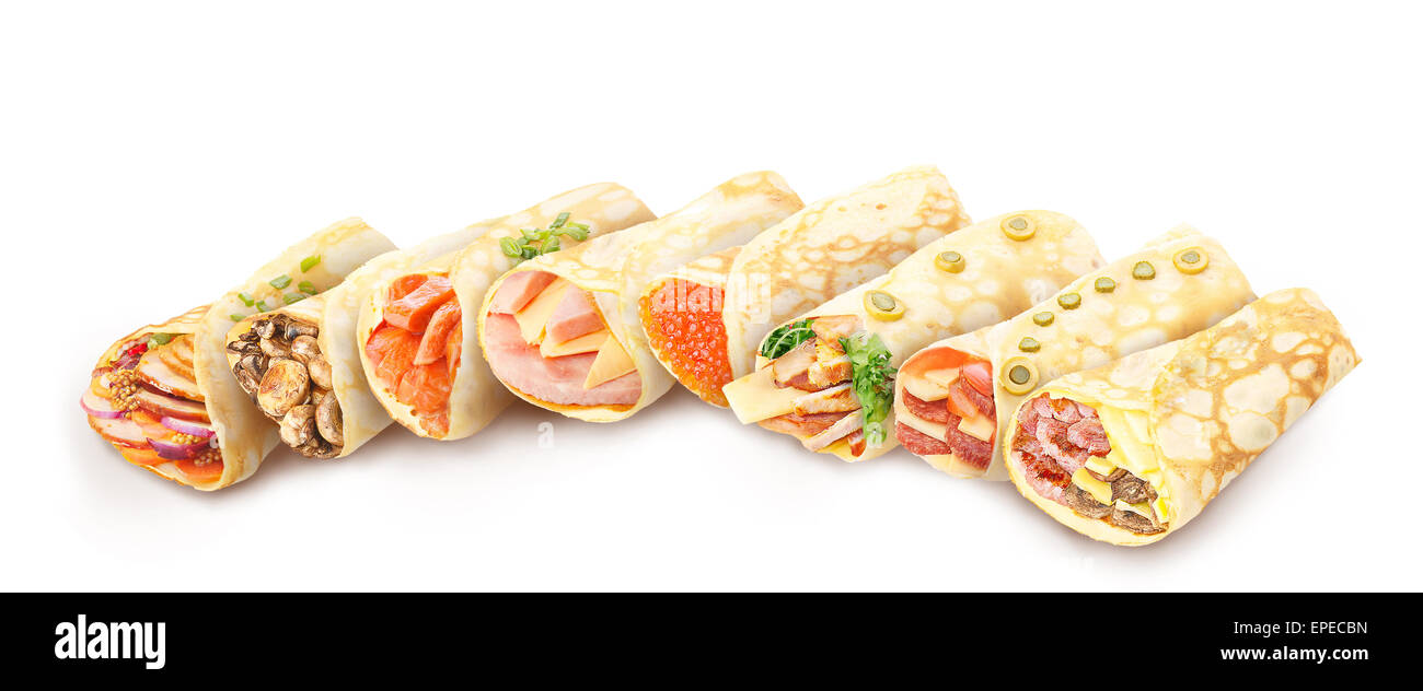 Big collection of elegant,neat, gourmet stuffed savory crepes decorated with herbs - Stock Image