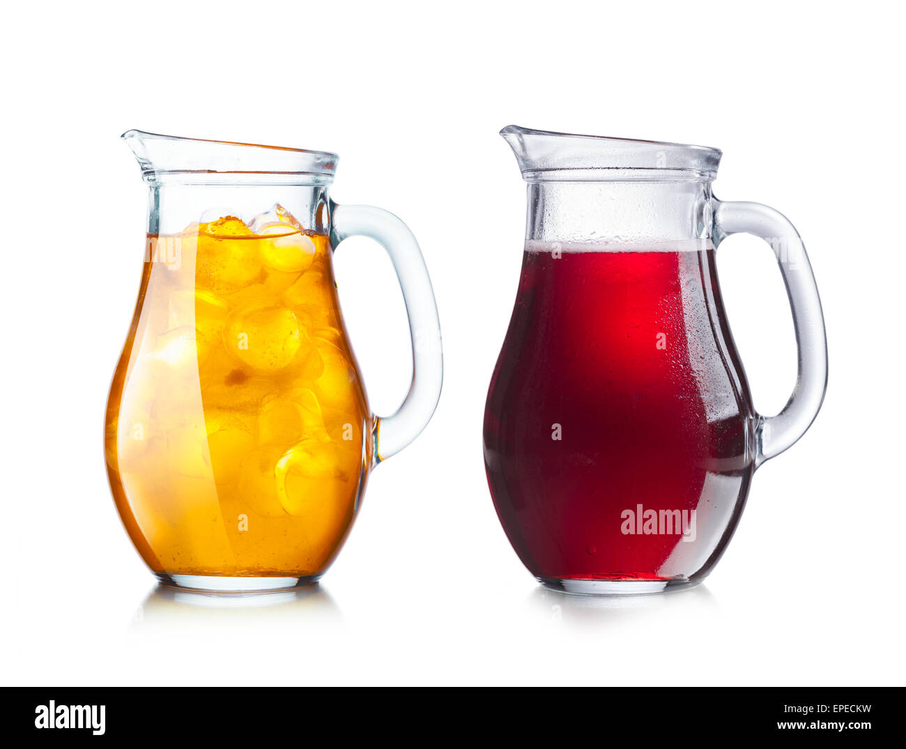 Two pitchers (jugs) with transparent and opaque liquids of dark and light tonality for easy color replacement. - Stock Image