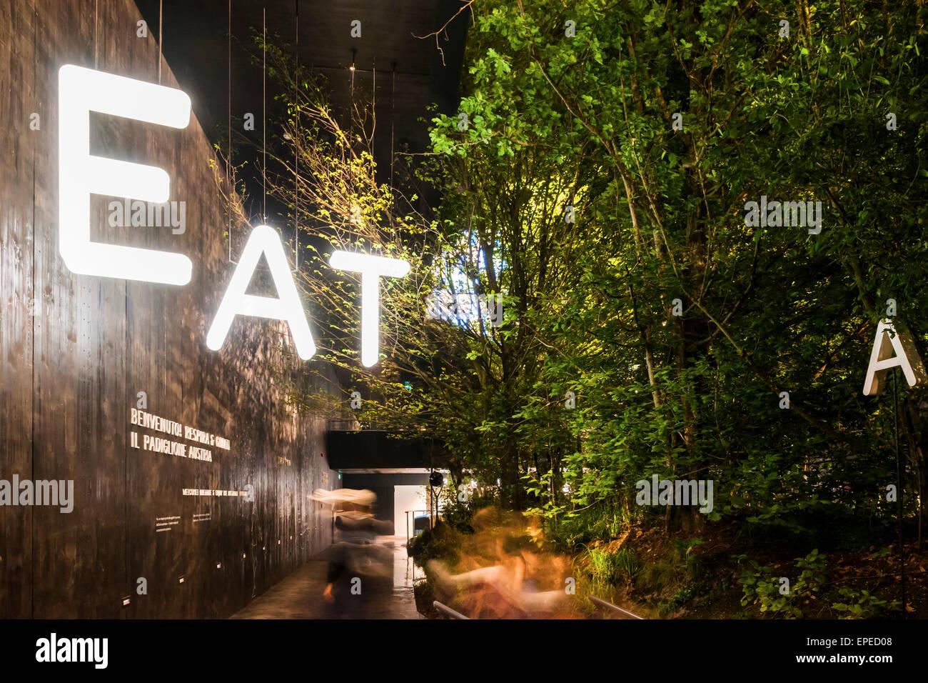 Illuminated facade perspective with forest garden. Milan Expo 2015 ...