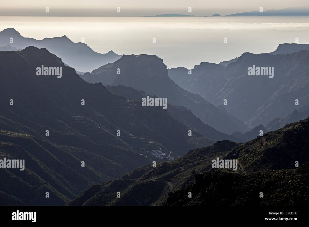 View from Roque Bentayga towards the mountains in the west of Gran Canaria, El Chorillo at the bottom, Canary Islands, Stock Photo