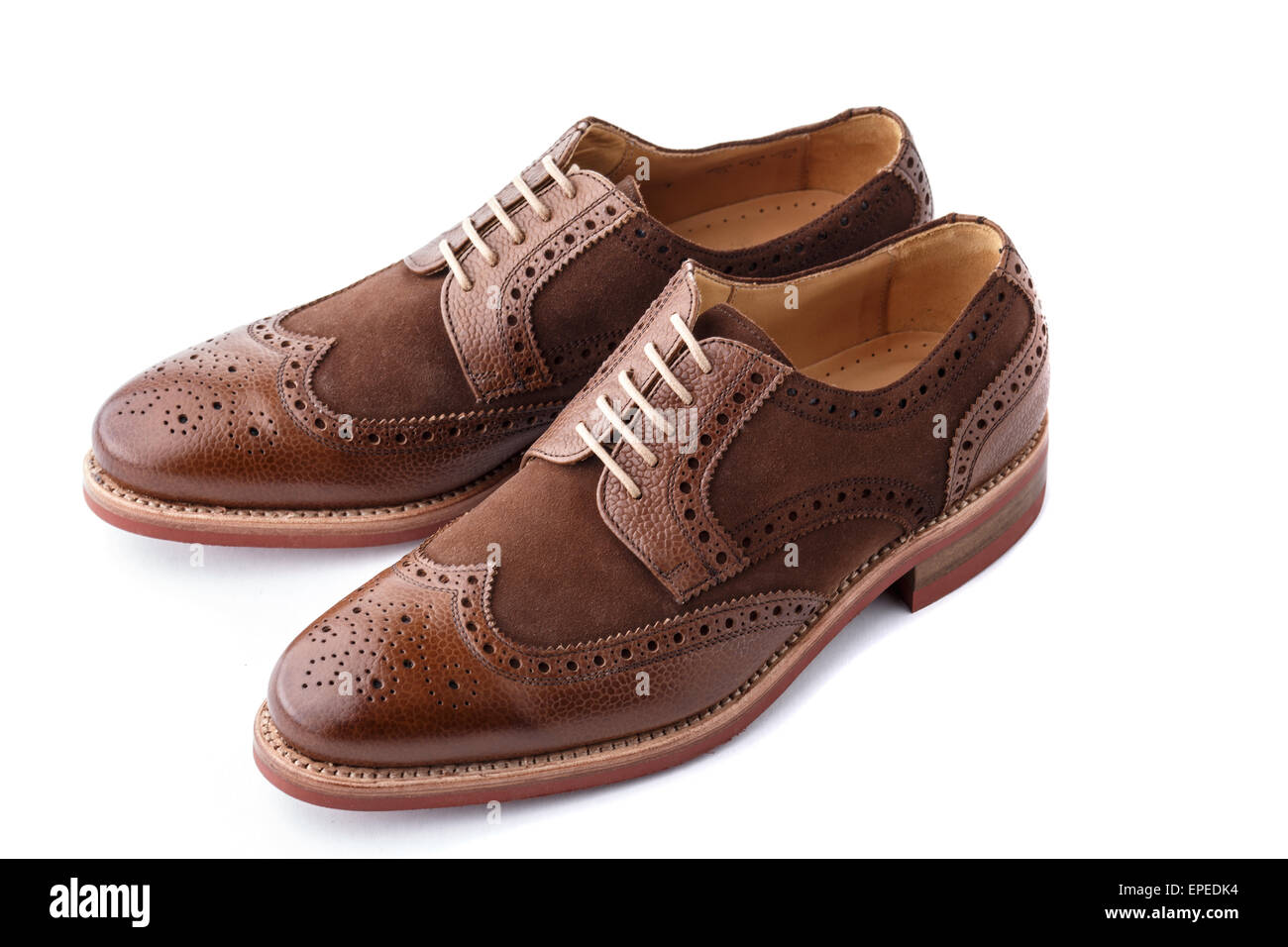 Unworn, laced pair of handcrafted shiny, two tone men brogues (also known as derbys, gibsons or wingtips) on durable - Stock Image